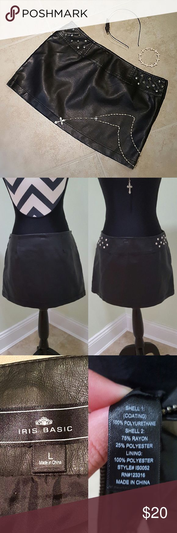 Faux Leather Skirt You could be out for a night with the girls or on the back of a motorcycle, this is a great statement to add to your wardrobe! Faux Leather with silver studs on both hips. Side zipper! Only flaws are minor pealing in a couple spots (pictured) next to my pinky. The peeling is from where the clamp from the hanger was at the top of the band. Price reflects flaws! iris basic Skirts Mini