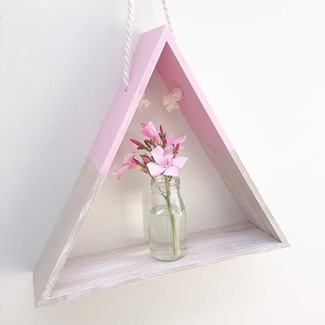@jjandmoo has added a splash of pink to the Kmart triangle shelf. It looks beautiful.