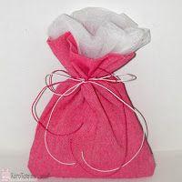 Lucas - Είδη Συσκευασίας: Όλα τα απαραίτητα υλικά για την κατασκευή μπομπονιέρας! Ροζ μπομπονιέρα με πούγκι απο λονέτα και λευκό ύφασμα στο εσωτερίκο, δεμένο με ροζ και λευκό κερόσπαγγο.