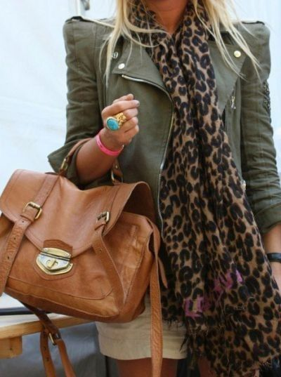 leopard scarf, brown bag, strong-shouldered olive green leather jacket, with khaki shorts.