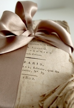 a great taupe satin ribbon and old book pages