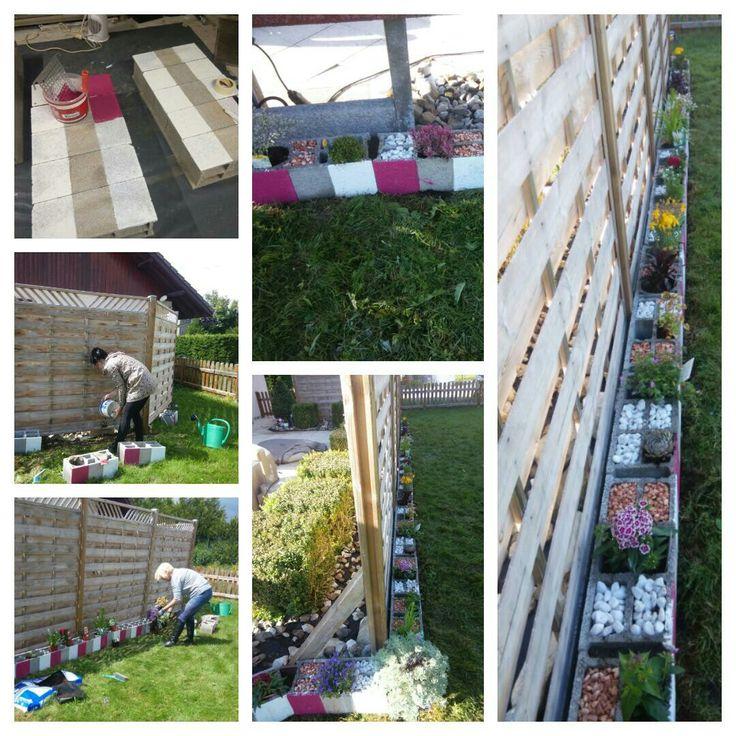 Bordures de jardin avec parpaings peint en blanc et fushia, composée de fleurs vivaces, graviers et galets