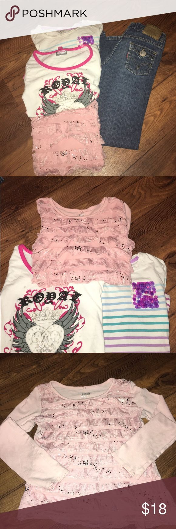 """FBundle- Girls 10/12 Justice Levi's - final price 3 long sleeve tops size 10/12, and one pair of Levi's size 10. Pink ruffle/sequined JUSTICE, White shirt """"royal princess"""" with peplum ruffle, Levi's with adjustable waist all in great condition. The white striped shirt has a spot on the left arm should come out with some oxy clean. Bundle priced accordingly. -Same or next business day shipping.  🚫Smoke Free Home. various Shirts & Tops Tees - Long Sleeve"""