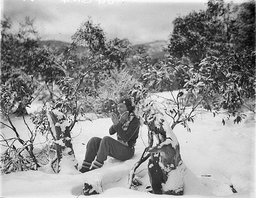 A woman skier making up her face amid the snow gums, c. 1930s, by Sam Hood   Flickr - Photo Sharing!