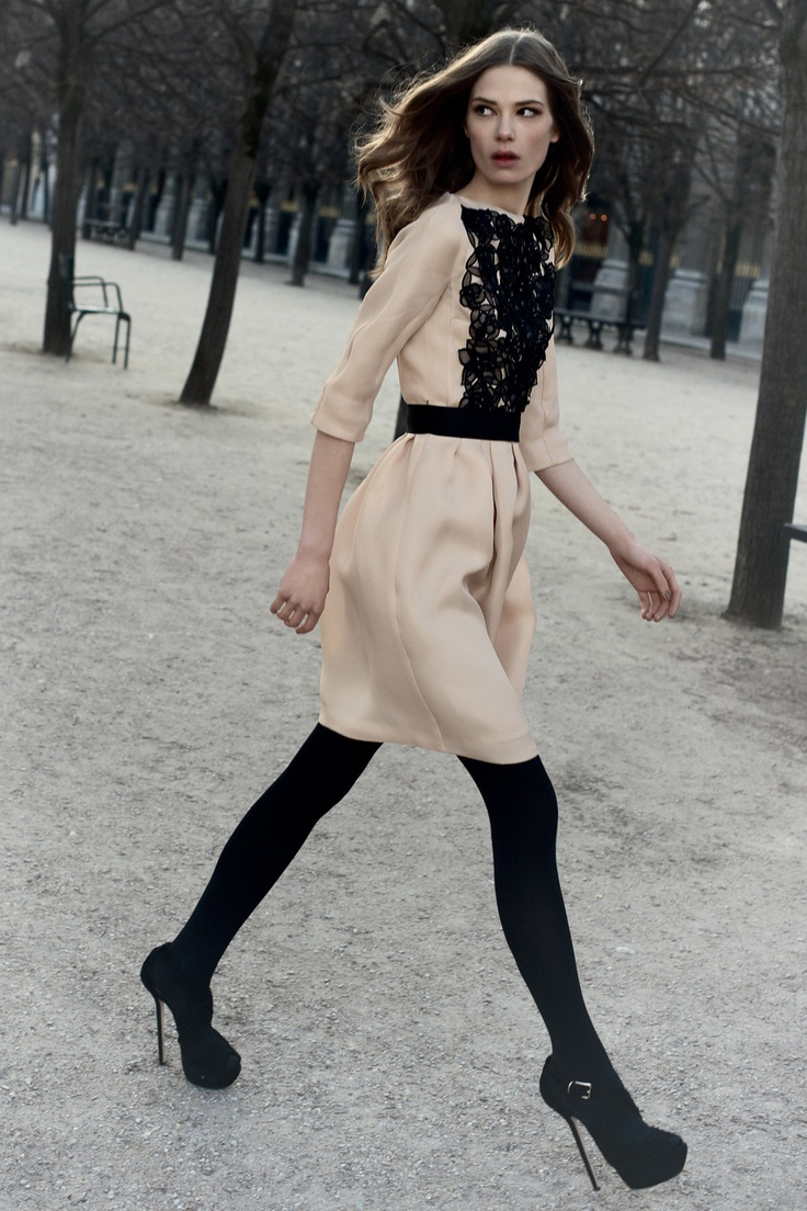 Champagne silk gazar dress with black leather satin waistband and beaded guipure embroidery / Dior official website