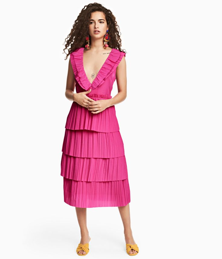 Neon pink. Calf-length dress in woven fabric. Low-cut V-neck with pleated ruffle at front and back. Tie and concealed zip at back, seam at waist, and flared