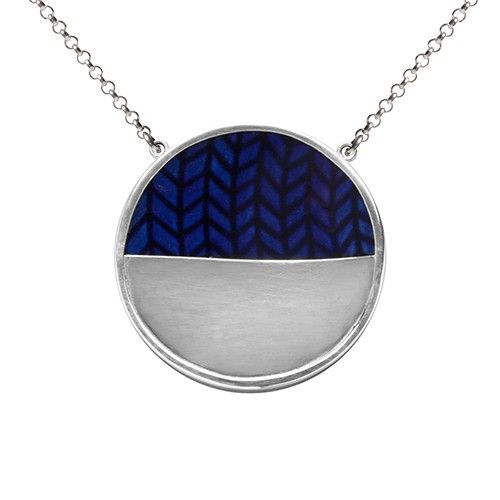I just love this necklace Blå Eld Halfmoon. It's made from recycled classic Swedish porcelain by Sägen who believes that it's important to keep things that have a story to tell. The blue porcelain makes a mighty chic match with silver. A modern retro dream as unique as you are.