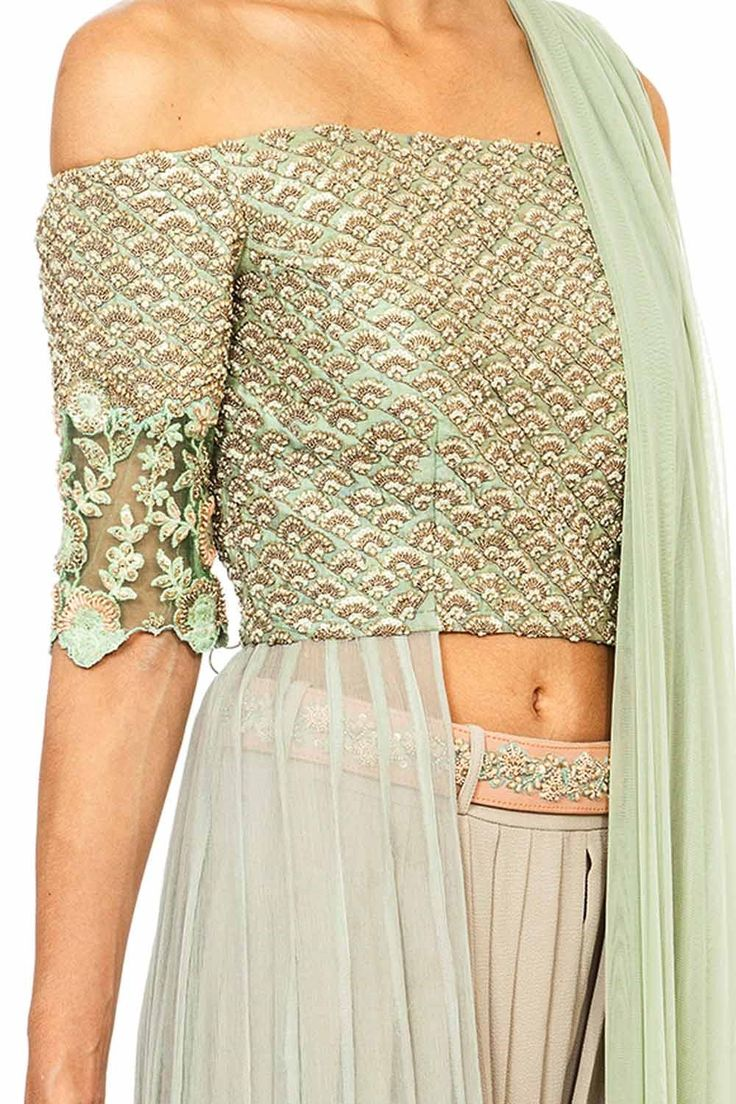 Featuring a mint green off shoulder front open anarkali set in chiffon base. It is appliqued with mint green and gold dori thread embroidery in seashell motifs on the bodice and sleeves and floral motifs along the hemline. It comes along with an attached dupatta and nude dhoti pants, accentuated with pink embellished detachable belt . Fabric: Georgette, Crepe, Chiffon Care Instructions: Dryclean only.
