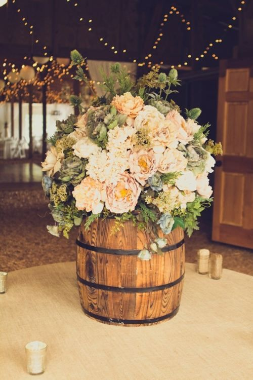 Rustic weddings can be glamorous too! How pretty is this floral arrangement? #weddingflowers #rustic