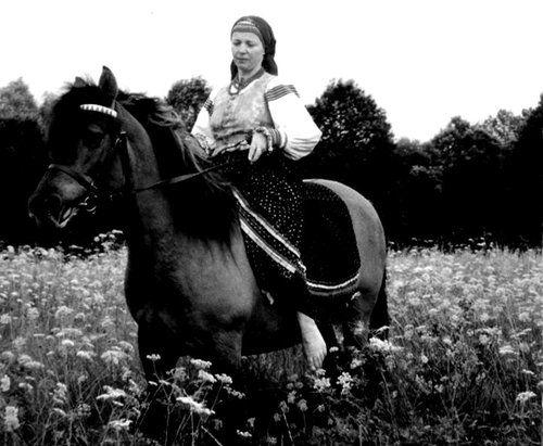 Lemko woman from southern Poland riding a horse
