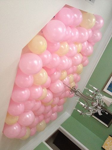 DIY: Balloon Decorations-   This took about 3 hours, 75 balloons, a normal pump (no helium), a ladder, and my AMAZING dad to help me :).   You blow up balloons just with normal old hot air and use painters tape to attach the balloons upside down to the ceiling!