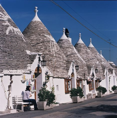 The trulli of Alberobello in the Puglia region of Italy are quaint little medieval houses... like  a Mediterranean hobbitsville.