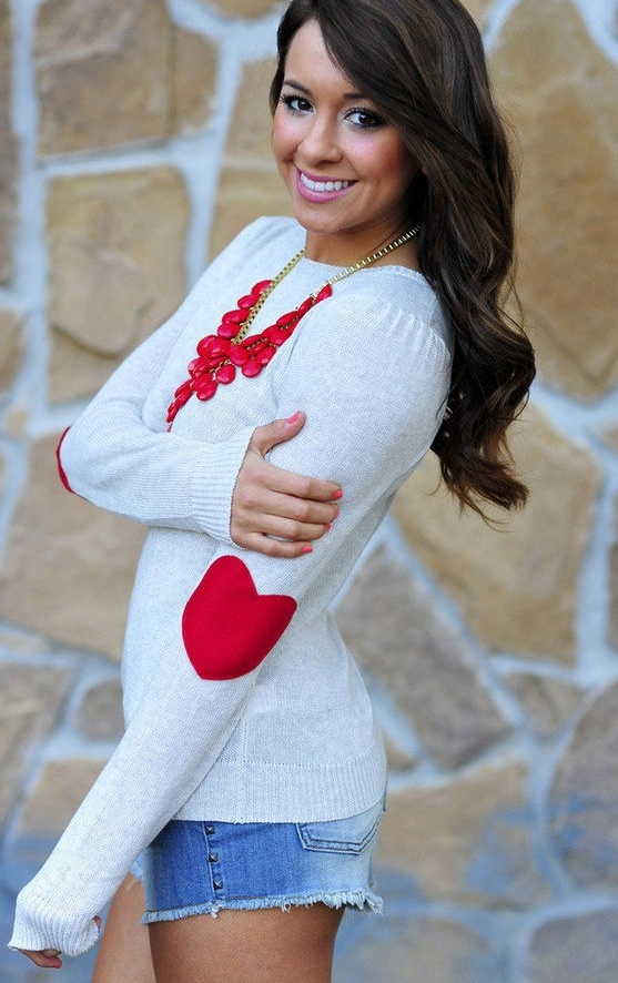 white long sleeve top w/ red hearted elbow patches & red bubble necklace.