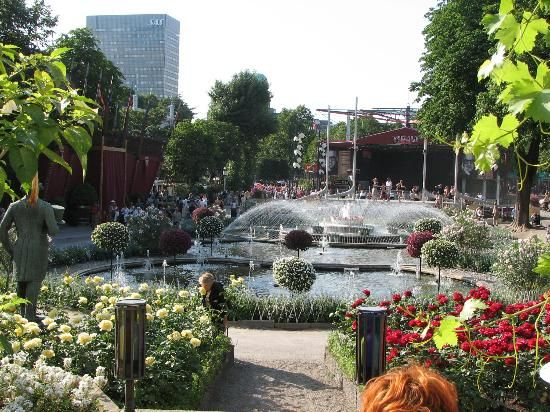 Tivoli Gardens, Copenhagen, Denmark. It tends to drizzle off and on in the summer, but that shouldn't stop anyone from visiting this magical theme park!