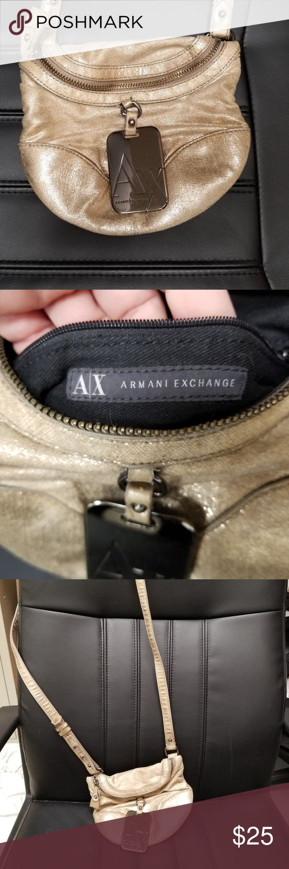 """Armani Exchange Distressed Gold Leather Crossbody beautiful condition - clean inside - minor scratches on metal logo (see pics).  This purse has a strap drop (from shoulder to bag) of approx. 24"""" and is adjustable.  The purse itself is 6.5"""" in length and 8"""" at its widest point.  The metal logo is approx. 2 x 3 inches. Armani Exchange Bags Crossbody Bags"""