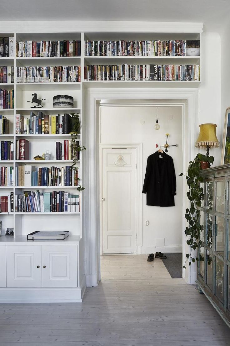my scandinavian home: A Charming Swedish Home With Pops Of Golden - and shelves over the doorway!