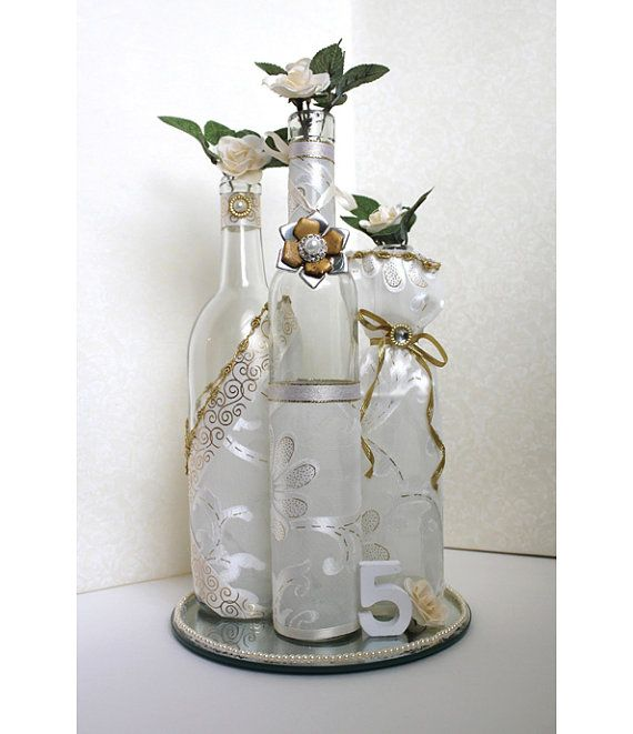 Best 25 decorate wine bottles ideas on pinterest for Using wine bottles as centerpieces for wedding