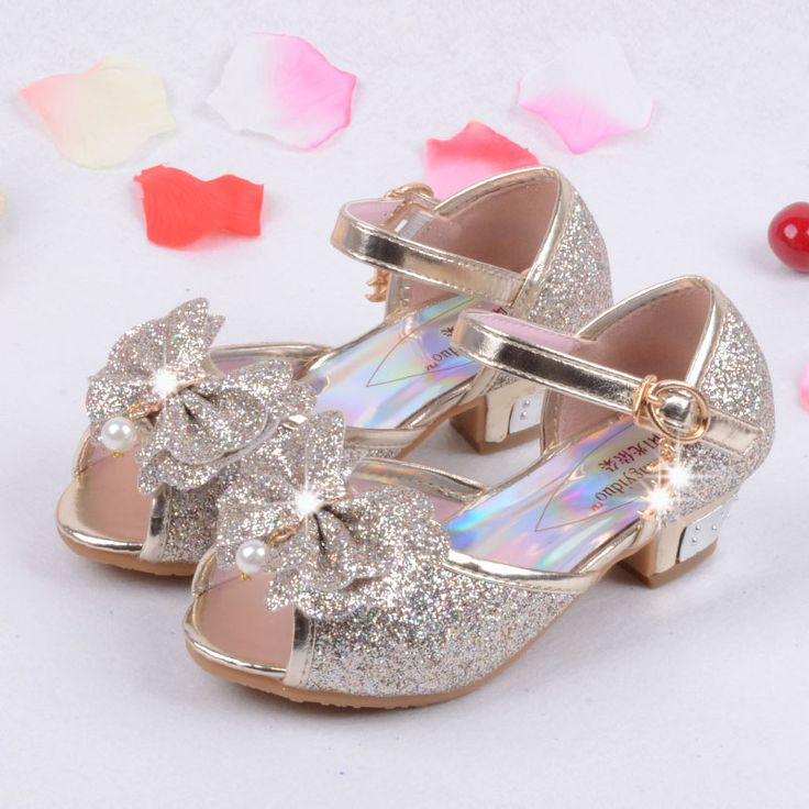 Kids princess shoes in pink, blue, and gold. They're perfect for wedding, special occassions, or dress up with sparkles, a small heel, and a bow at the front. $14.50 - $20 from Aliexpress