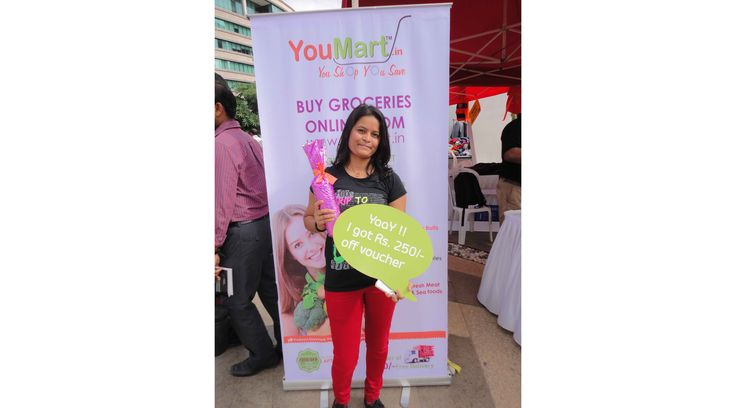 During the 'Christmas Carnival' event organized by YouMart, happy shoppers had an opportunity to buy huge amount of groceries at discounted price. One of the participants seen in this image, posing with the discount voucher offered for every purchase of a product.