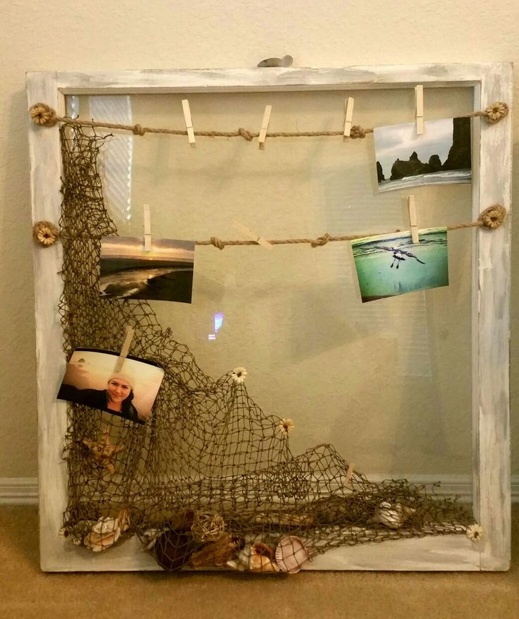 net with sea shell decor and old fishing rope for hanging beach photos