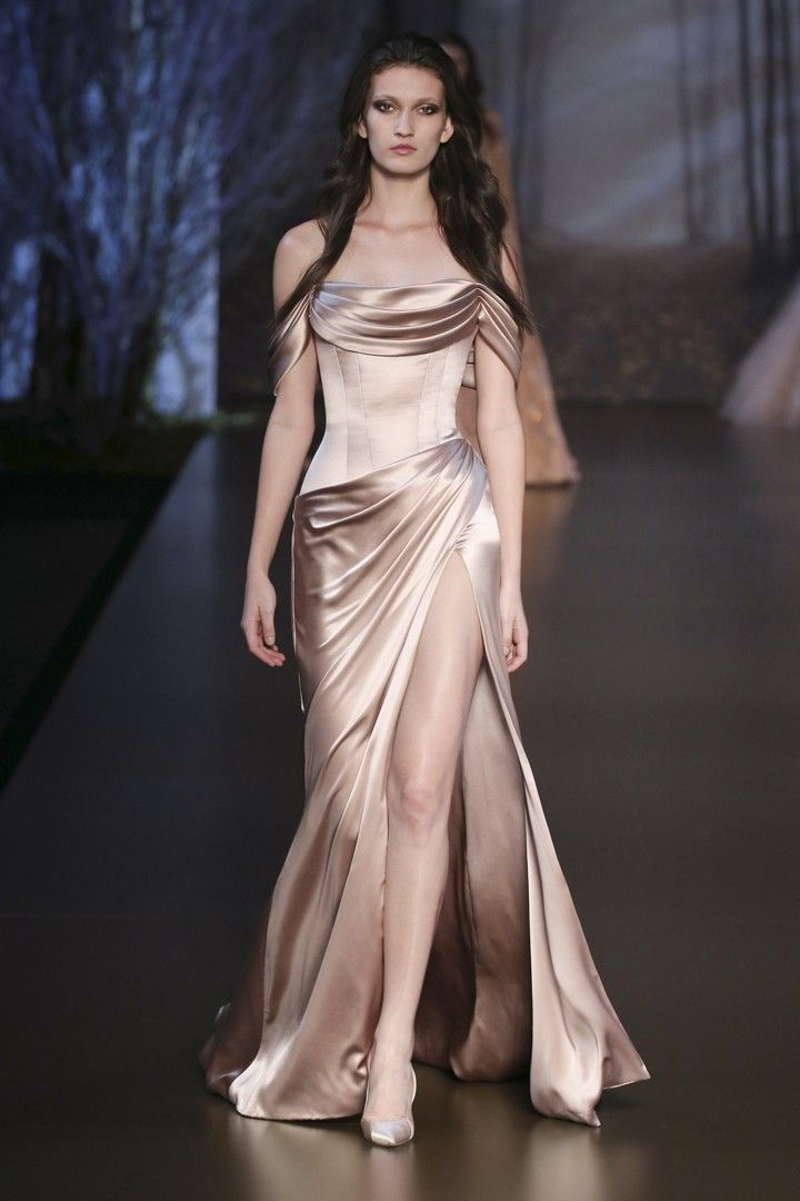 Metallic rose pink silk double satin corseted gown with asymmetric drapes. Ralph and Russo