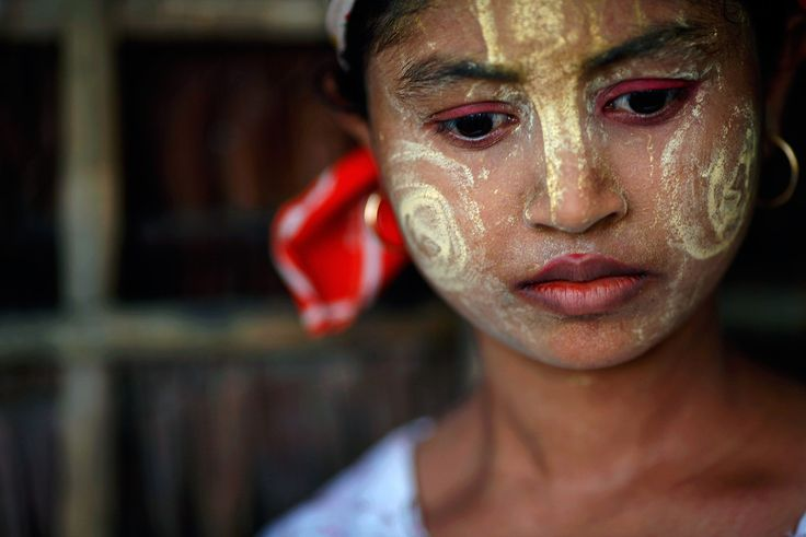 """An ethnic Rohingya girl wears traditional make-up in the village of Takebi north of the town of Sittwe, on May 18, 2012. Some 800,000 Rohingya live in Burma's northern Rakhine State under severe government restrictions that human rights monitors believe has fueled the current violence between predominantly Buddhist and Muslim communities that left a number of dead and houses burnt on both sides. (Reuters/Damir Sagolj)"""