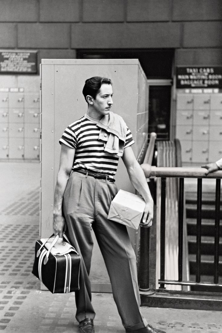 1947 Classic mid-century high-waisted trousers, with a sailor's top, by the lockers at Penn Station.