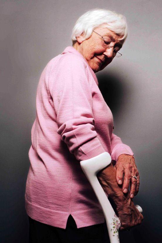 elderly lady with crutch_  Damian O'Sullivan Design