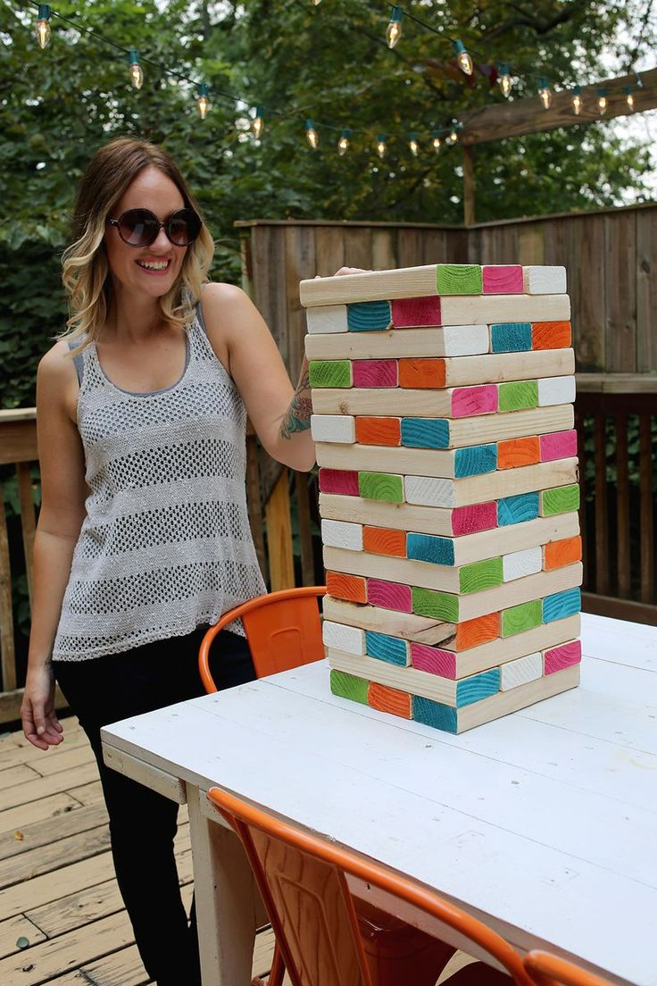 giant jenga First you need to buy enough 2x4 boards to cut into forty-eight 10 1/2 inch pieces. You can cut the boards yourself or have them cut at your local lumber yard. Try to avoid wood that has large knots or holes in it. Next sand all the edges, so everything is smooth and can slide easily across each other.