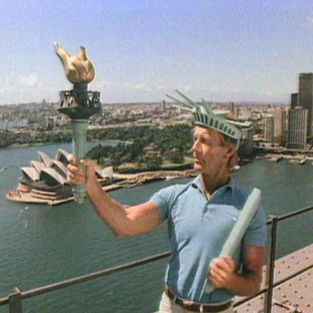 """Paul Hogan and the Sydney Harbour Bridge promoting Australia as a tourist destination for Americans. It was part of the same series that made the """"slip an extra shrimp on the barbie"""" line Yankee-famous (yeah, no Aussie has ever said it). The ads were prod"""