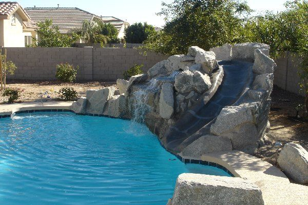 Pool Designs With Rock Slides pool design natural sophisticated waterfall fountain with rock stairs and water slides for custom pool Phoenix Az Pool Builders Rock Grotto Slide Rock Grotto Slide Pinterest Pool Builders And Swimming Pools