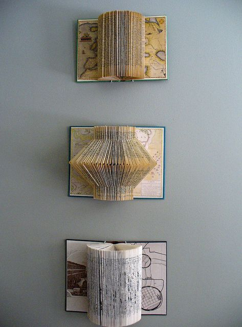 ReFab Diaries: Upcycle: Book folding - Free patterns,. Saw these in a wonderful boutique in town, very pricey. Now I know what to do those long winter nights with my thrift store old books. It will be meditative.