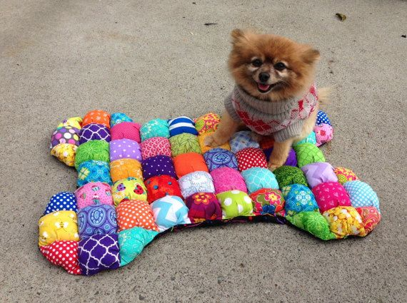 I recently found my most favorite Etsy seller EVER! She specializes in making bubble quilts which are fantastic for dogs, babies, chair cushions, and so many more ideas. Her shop is called MichellesEye so go browse around and check it out! If you don't want to buy them, I found a tutorial here. How adorable …