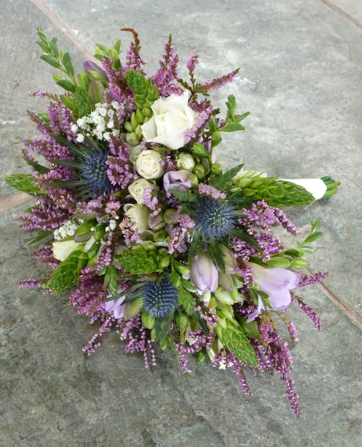 Beautiful Brides Bouquet created with Spray Roses, Freesia, Eryngium, Gypsophilia, Chincherinchee and Heather. The Heather f...