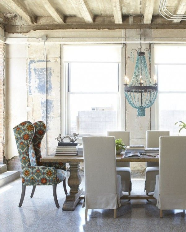 Love the exposed beams and the turquoise beaded chandelier