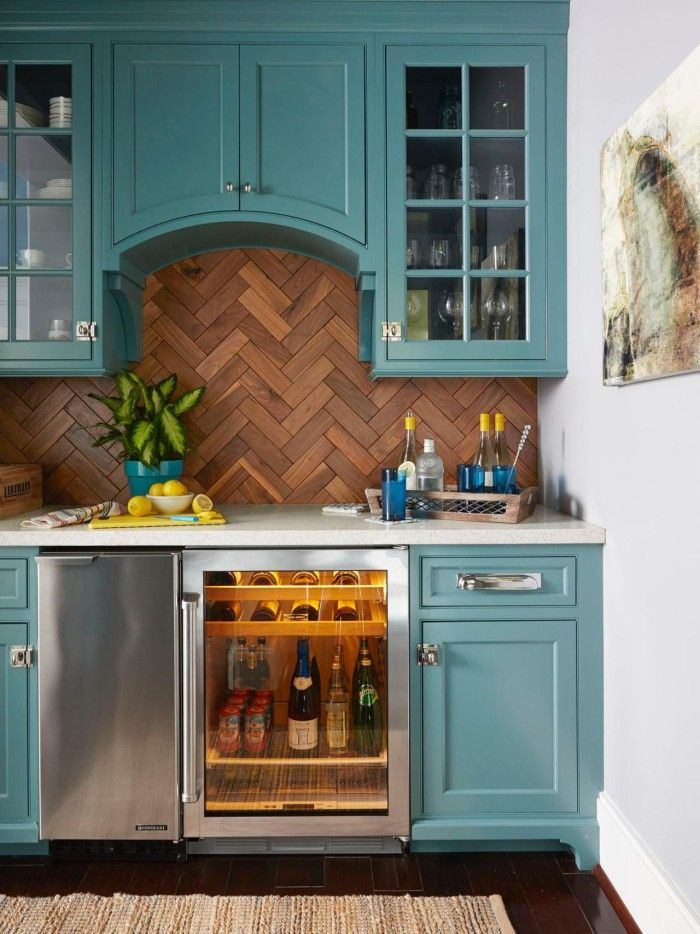 "This is the butler's pantry from HGTV star Chip Wade at home in Atlanta - But with the gorgeous cabinetry (check out those arched doors and beautiful latches!) and lacquered herringbone wood ""tiles,"" on the backsplash, I'd love an entire kitchen like this!"