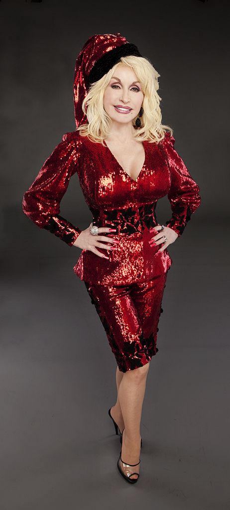 Dolly Parton in a glamorous Christmas outfit.