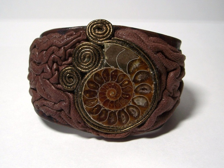 Adjustable brown leather bracelet cuff with Ammonite fossil piece. $40.00, via Etsy.