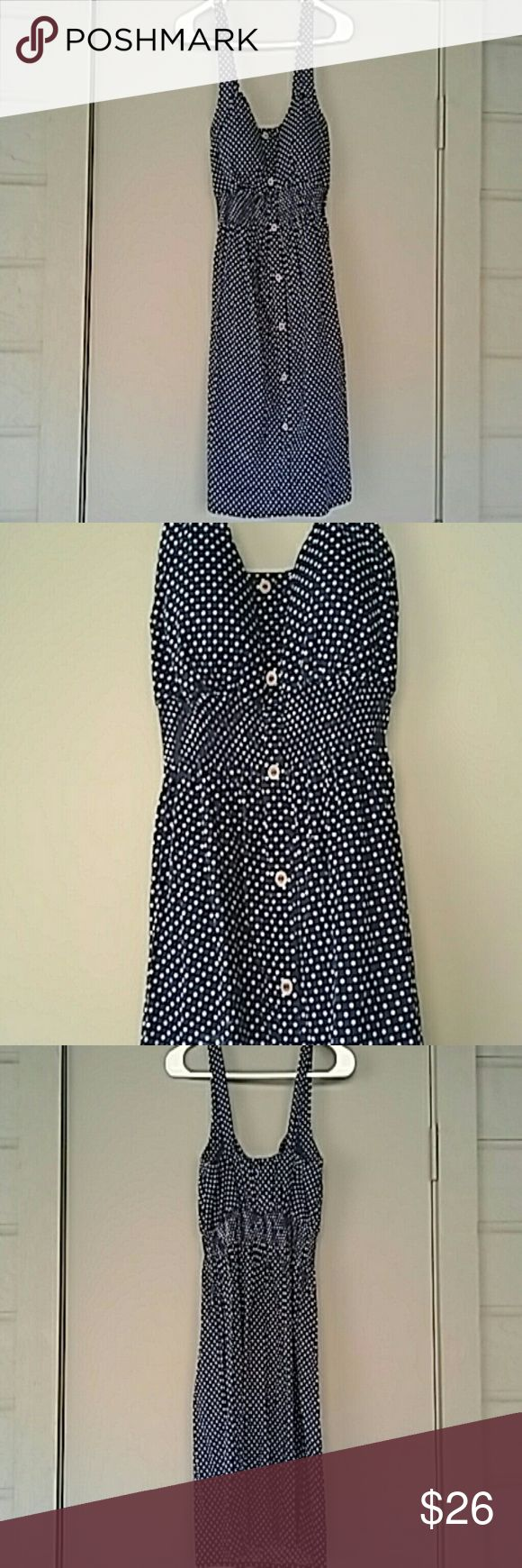 Super cute blue and white polka dot summer dress! Blue and white polka dot dress with brown buttons up front. Stretchy empire waist. Great for some summer fun! Rhapsody Dresses Mini