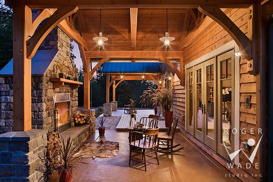 Another beautiful porch. Timber frame architectural stock photography, timber frame patio looking out to mountain view and setting sun, private residence, yellowstone club, montana, locati architects, design associates, schlauch bottcher construction