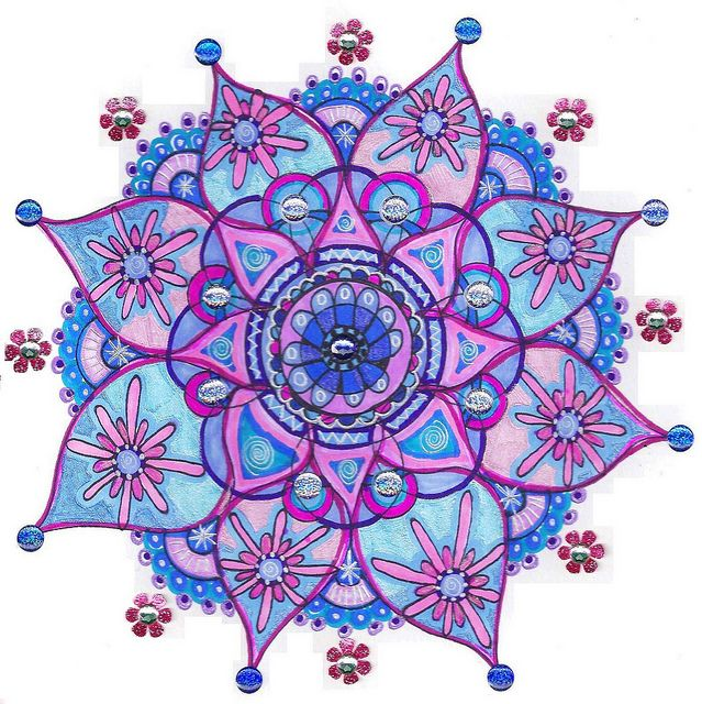 A mandala is a sacred space often a circle which reveals inner truth about people and the world around them. Repetition in colours and shapes of the circles and petals offer balancing visual elements, symbolizing unity and harmony.