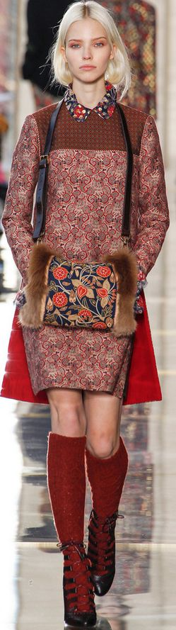 This is a look from Tory Burch fall 2014. This outfit features a muff. Muffs were hand coverings popular during the empire period.
