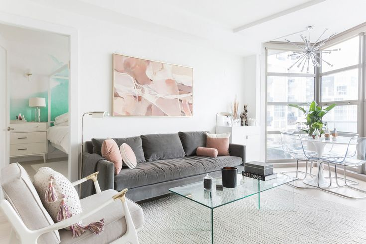 grey sofa with pink accents in a minimalist living room