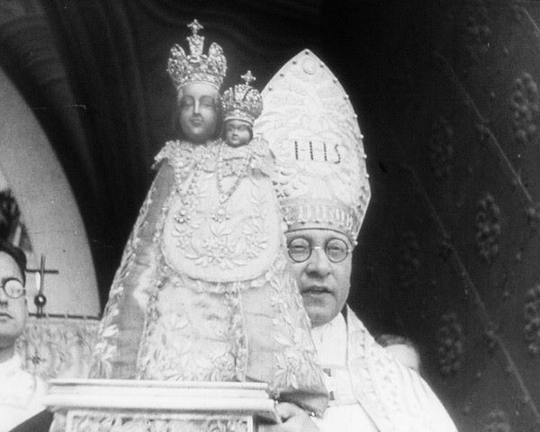 General vicar of the Archdiocese of Prague Dr. Msgre. Bohimil Opatrný with statue of Virgin Mary from Svatá Hora, 40s