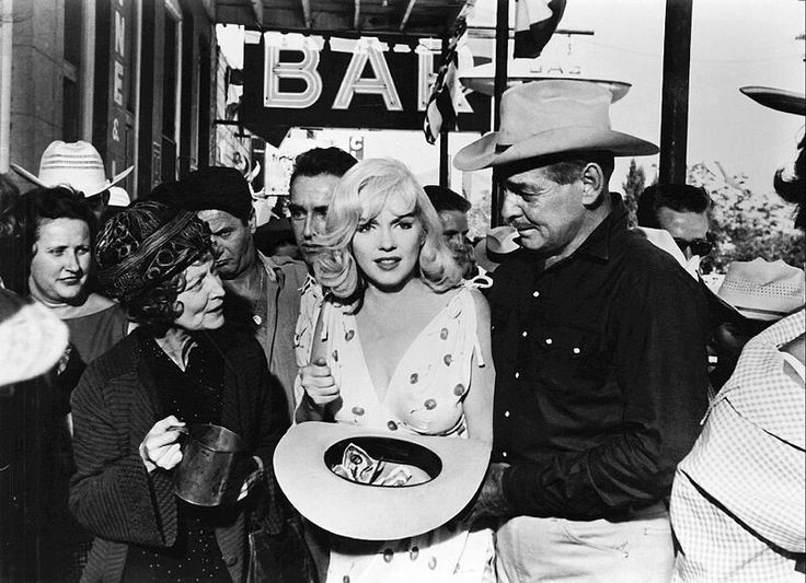 With Clark Gable, Montgomery Clift, Eli Wallach, and Estelle Winwood in The Misfits. It was last completed film for both Monroe and Gable.