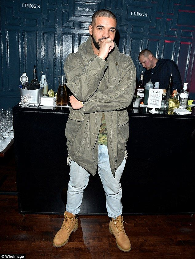 Casual and hip: Drake wore jeans with a camouflage shirt and khaki jacket for his big nigh...