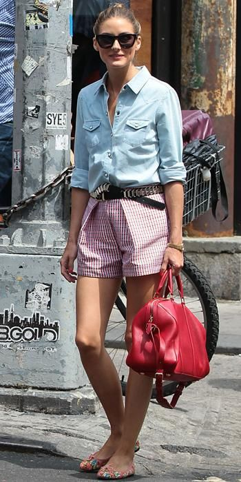Palermo went casual chic with a light washed chambray shirt tucked into a pair of printed shorts. She finished off her look with a black-and-silver belt, cherry-red duffel and printed ballet flats.