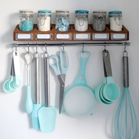 Sprinkles sit on top of the shelf, while all of the tools hang below from hooks (including your trusty whisk, measuring cups, and spatula). But you really know you've reached expert baking status when all of your accessories are in the same lovely blue hue. Click through for more on this and other baking storage ideas.
