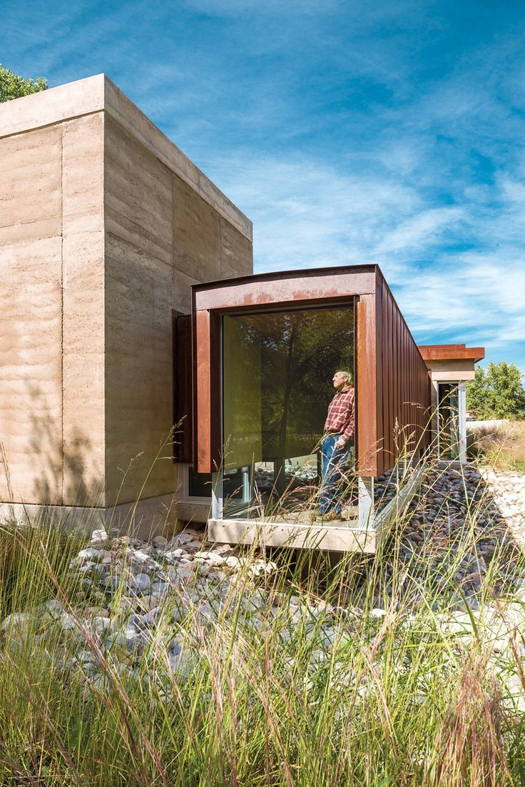 Rammed earth and corten  steel containers with protective rust patina