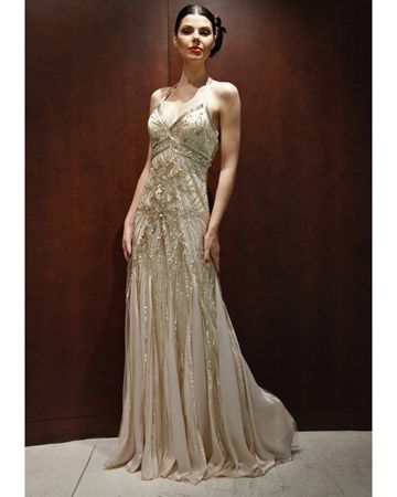 This sparkling number is accented with beaded sequins and a satin godet skirt.